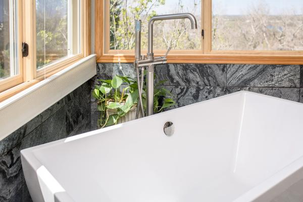 Modern freestanding bathtub and quartzite tile