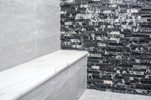 Black stacked stone and white quartzite stone in shower