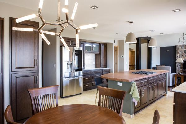 Traditional kitchen with modern dining room light