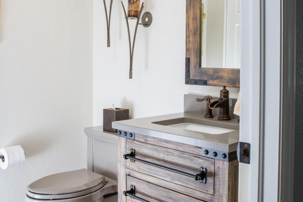 Rustic style powder room design in Littleton, Colorado
