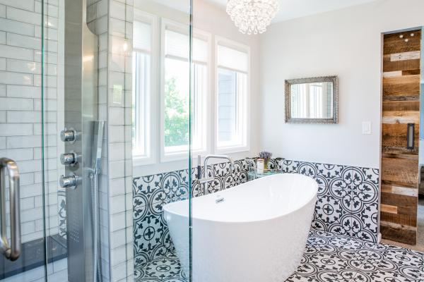 Transitional style bathroom design with free standing bathtub