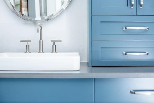 Blue vanity cabinets and vessel sinks