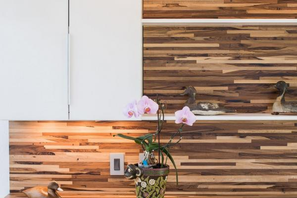 Butcher block backsplash with modern pendant light