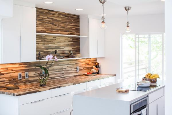 Modern white kitchen with wood backsplash