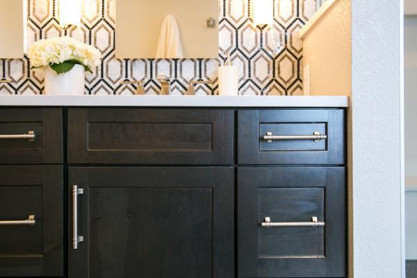 Detail of master bathroom dark wood vanity