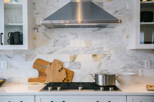 Detail of range hood and marble backsplash