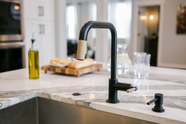 Black faucet and marble look quartz countertops