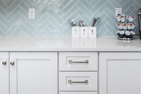 Gray cabinets with stainless steel hardware