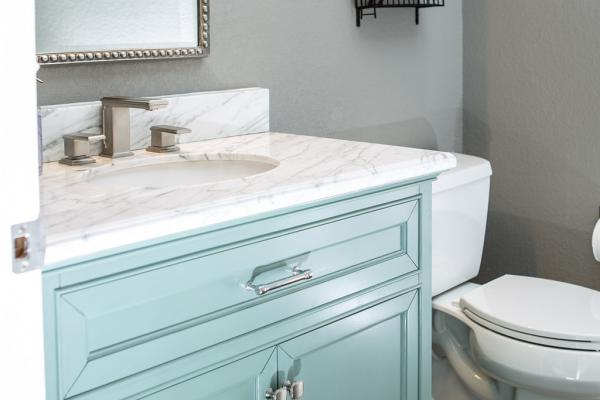 Teal cabinet powder room
