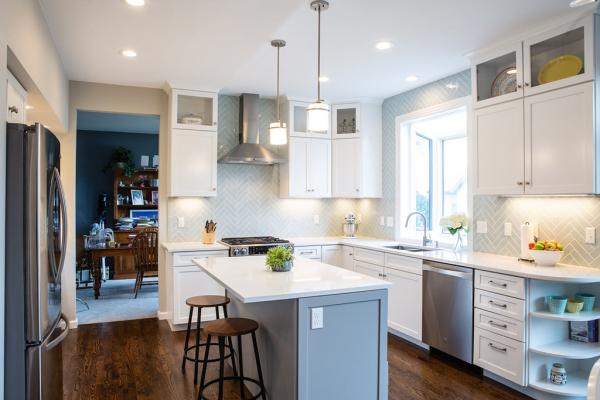 White cabinets with gray island