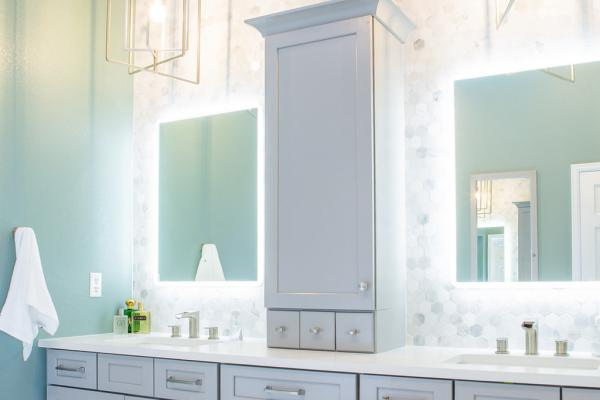 Gray bathroom vanity with hexagon tile