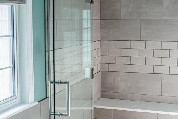 Shower with frameless glass