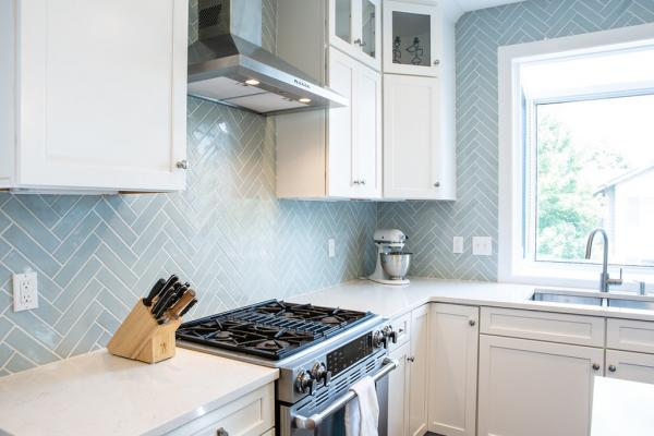 Blue herringbone backsplash and white countertop