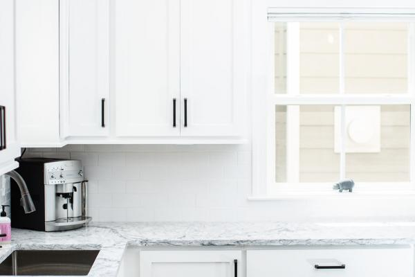 White cabinets with marble look countertop
