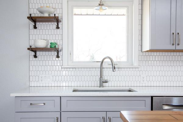 Gray kitchen with white backsplash