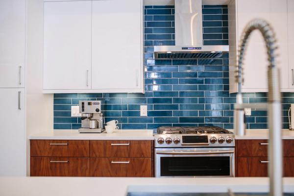 Blue backsplash and steel faucet
