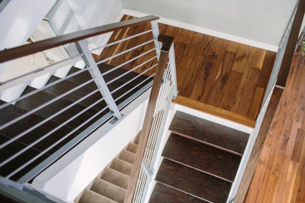 modern staircase with steel railing