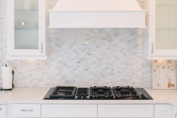 White kitchen hood and backsplash