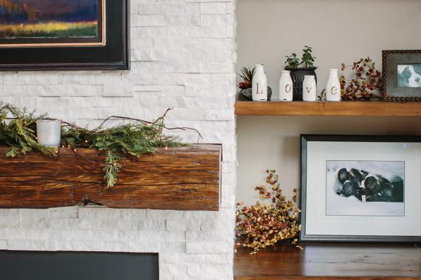 Rustic stacked stone fireplace with mantle