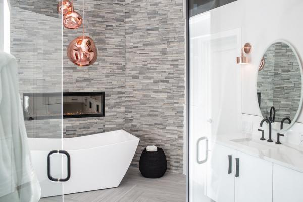 Stacked stone wall and white vanity
