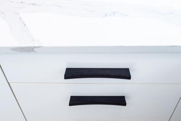 Black hardware on white drawers