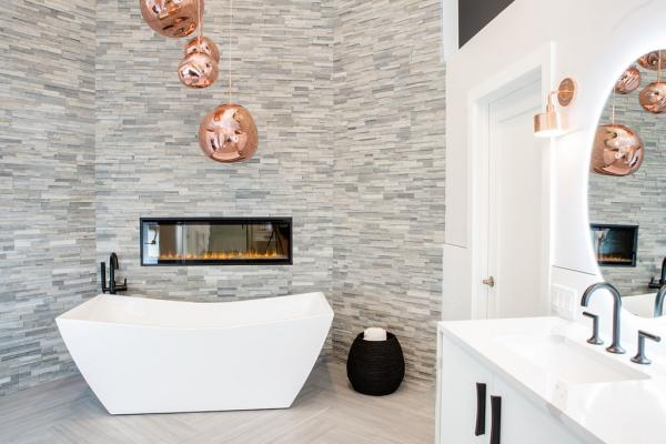 Stacked stone wall behind tub
