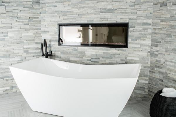 Freestanding bathtub and fireplace