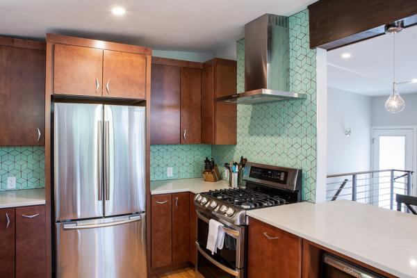 Kitchen with green backsplash tile