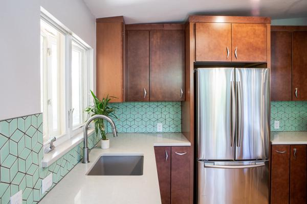 Green backsplash with white countertops
