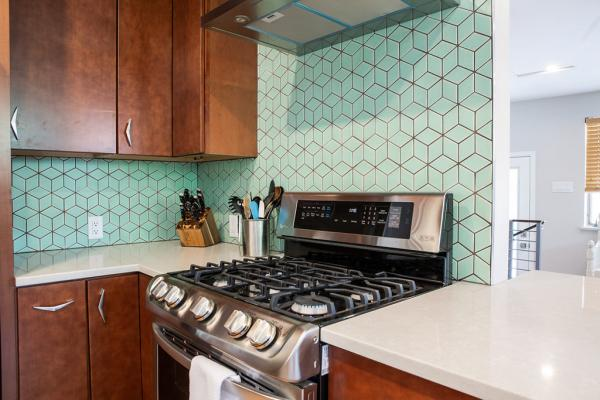 Range against green backsplash