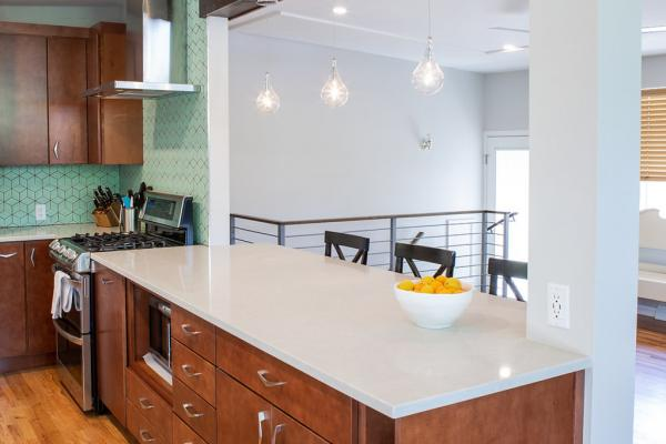 Wood cabinets with white countertops