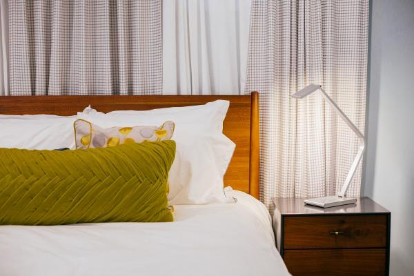 Guest bedroom with nightstand light