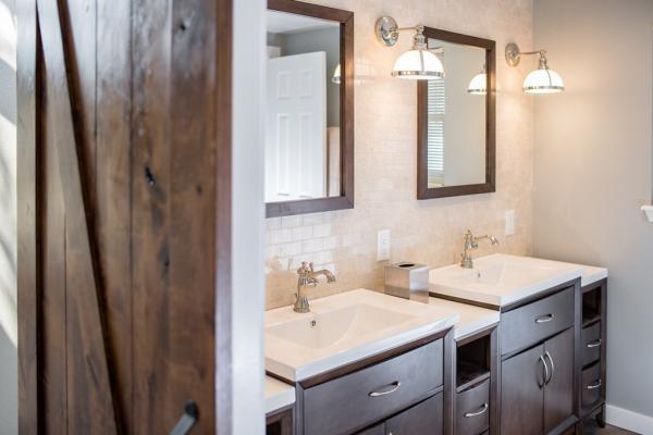 Rustic barn door entry into bathroom