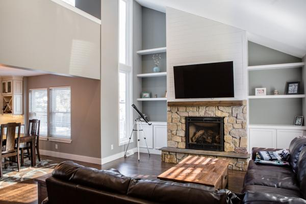 Large living room with stone fireplace