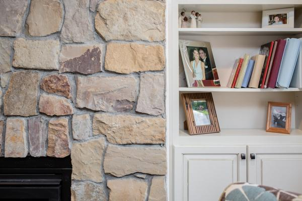 Stacked stone fireplace with shelves