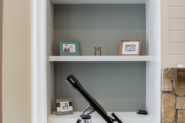Custom bookshelves next to fireplace