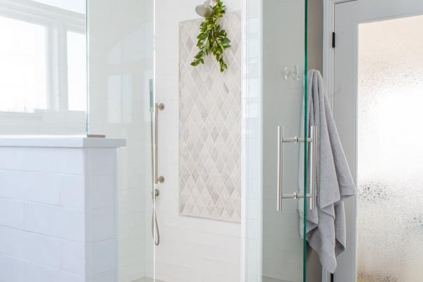 Custom shower with tile and eucalyptus