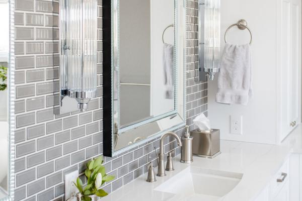 White vanity cabinets with quartz countertop