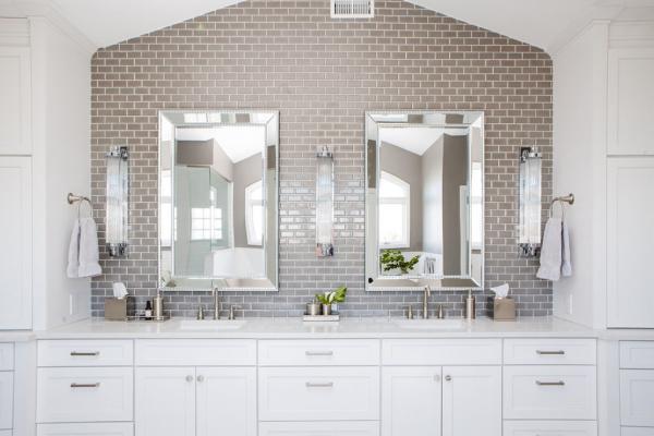 Large vanity wall with brick backsplash