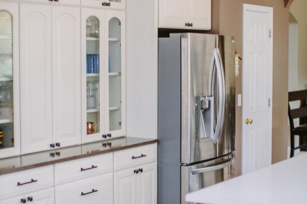 Cream cabinets with brown walls