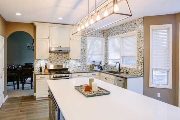 Traditional kitchen with mosaic backsplash