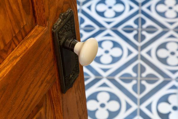 guest bathroom door and floor tile detail