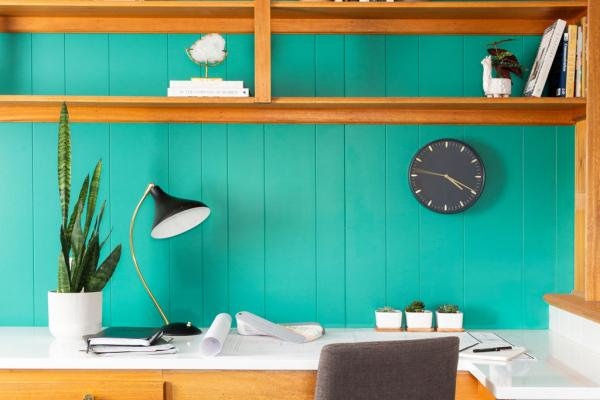 home office with bright emerald accent wall