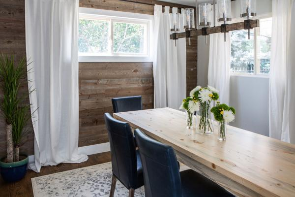 dining room with wood clad wall