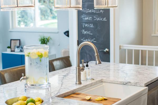 farmhouse sink, cabinetry and pendant lights