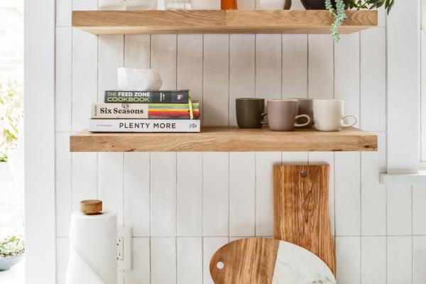 detail view of floating shelves and backsplash