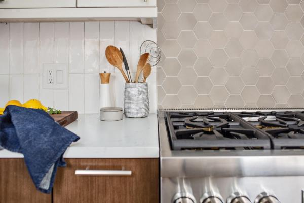 detail view of countertop and backsplash over range