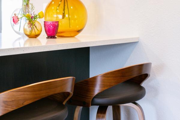modern stools under bar overhang at peninsula