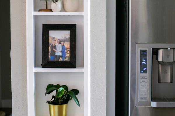 storage niche next to refrigerator