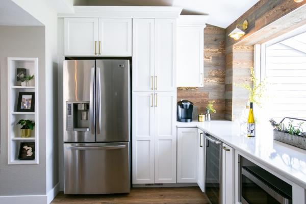 view toward refrigerator and tall cabinets